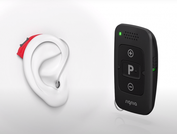Signia minipocket with hearing aid on ear